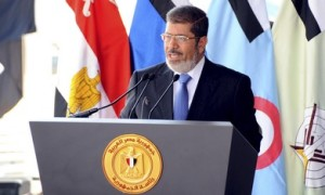 Egypt's President Mohamed Mursi speaks during his visit to the 6th armored division of the second army, in Ismailia