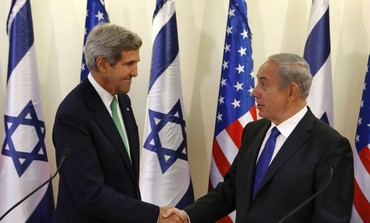 U.S. Secretary of State Kerry shakes hands with Israel's Prime Minister Netanyahu at the prime minister's office in Jerusalem