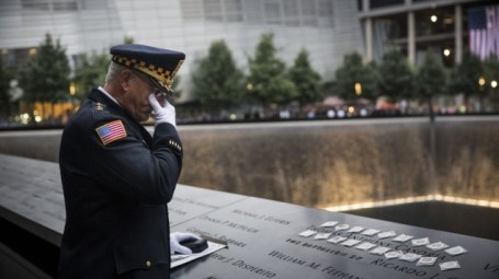 Sam Pulia, mayor of Westchester, Ill., and a former police officer of the same town, mourns over the name of his cousin, New York firefighter Thomas Anthony Casoria, who was killed in the South Tower in the attacks of Sept. 11, 2001, prior to the the memorial observances held at the site of the World Trade Center in New York, Thursday, Sept. 11, 2014 (photo credit: AP/Andrew Burton, Pool)