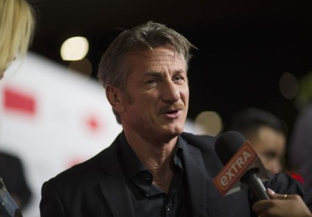 "Penn is interviewed at the premiere of ""The Gunman"" in Los Angeles"